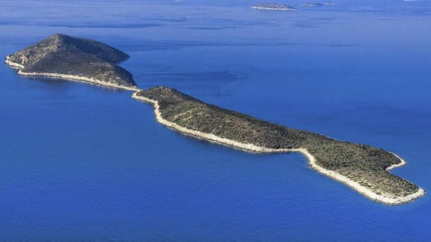 Tim Cook's spare change could buy a Greek island or two.