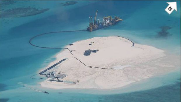 A Chinese vessel, top center, in the Spratly Islands at South China Sea, in this photo taken by a Philippines surveillance plane last year.