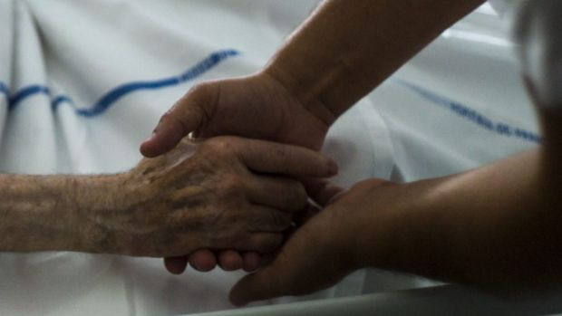 A terminally ill patient would have to ask for help to die three times under proposed reforms.