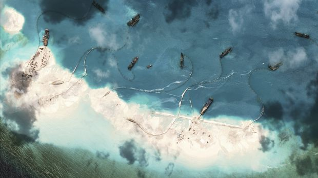 A satellite image supplied by the US-based Centre for Strategic and International Studies shows Chinese dredgers working at the northernmost reclamation site of Mischief Reef, part of the Spratly Islands, in the South China Sea, on March 17.
