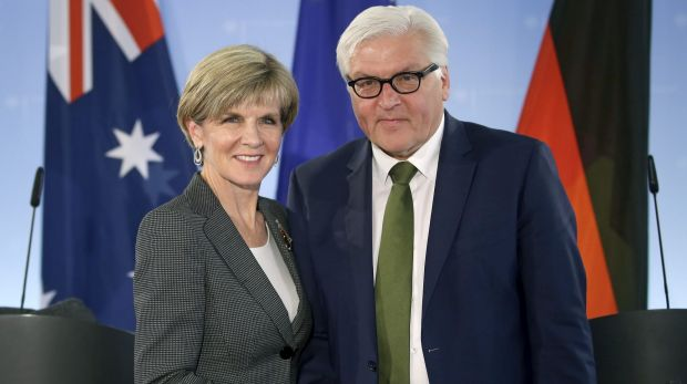 German Foreign Minister Frank-Walter Steinmeier, right, and Julie Bishop, left, shake hands after a joint press conference as part of their meeting in Berlin, Germany.