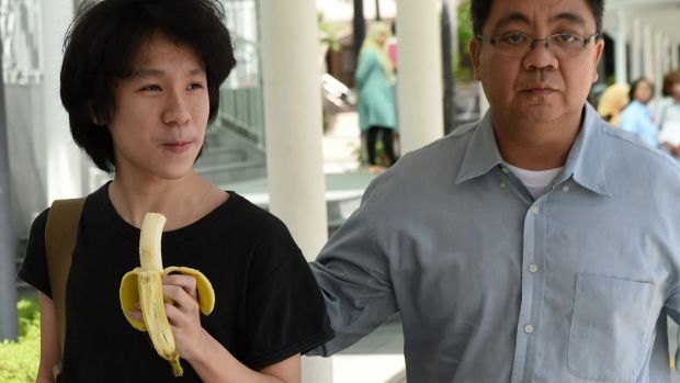 Amos Yee walking with his father to the state courts in Singapore.