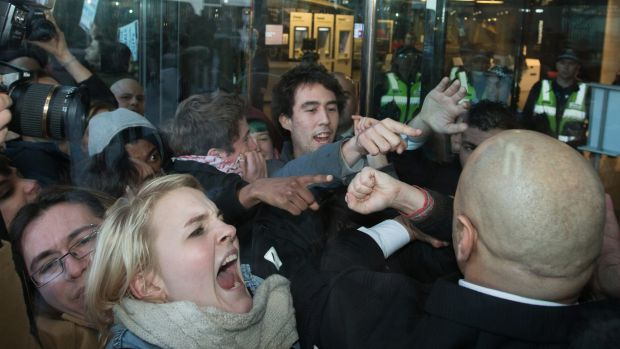 Demonstrators clash with police outside NAB headquarters in Melbourne's Docklands.