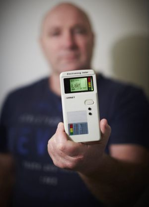Bruce Evans with his smartphone-sized digital meter.