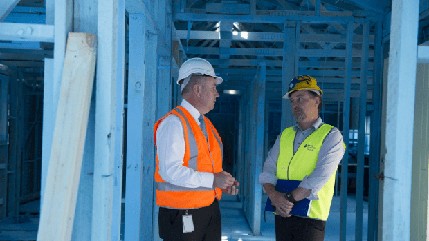 Asbestos taskforce boss Andrew Kefford and Shaw Building general manager Roger Poels inside a Canberra Mr Fluffy asbestos house in Scullin