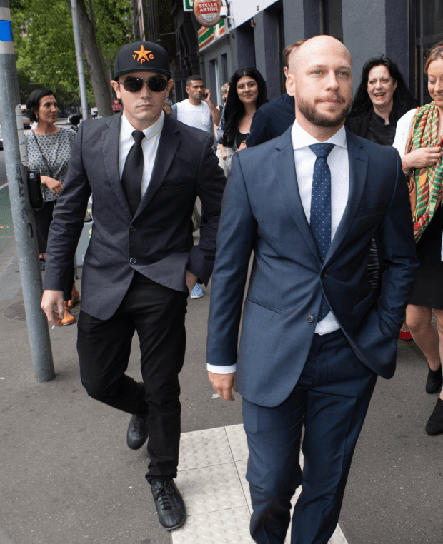 Jamie Williams (right) leaves court after federal prosecutors dropped their case against him. Mr Williams had been accused of trying to fight against Islamic State