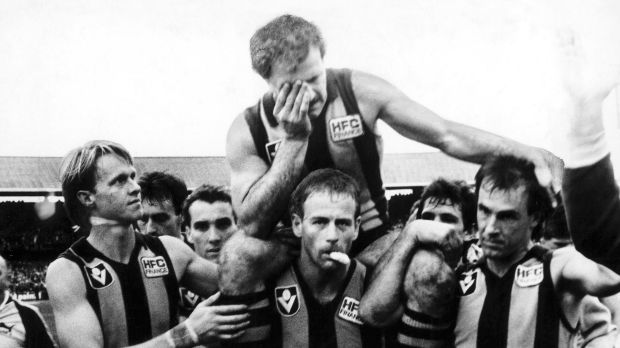 Leigh Matthews chaired off after his final game.