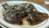 The flounder is roasted in olive oil and served with burnt butter sauce.