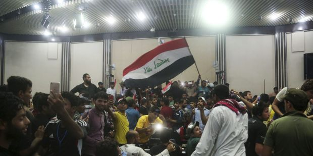 Supporters of Shiite cleric Muqtada al-Sadr storm parliament in Baghdad's Green Zone.