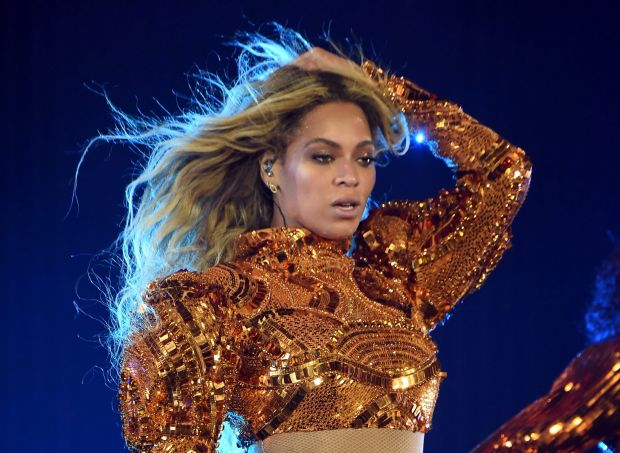 It's time to take action on police shootings, Beyonce has told fans.