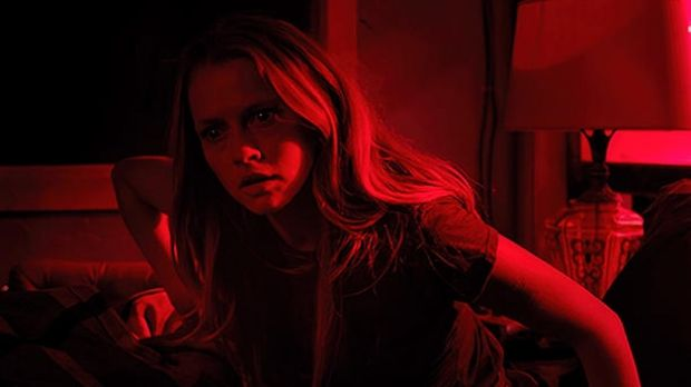 Seeing red: the hapless Teresa Palmer wastes her time, and ours, in the unforgiveably dull horror film Lights Out.