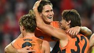 SYDNEY, AUSTRALIA - SEPTEMBER 10:  Lachie Whitfield, Rory Lobb and Ryan Griffen of the Giants celebrate winning the AFL ...