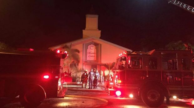 Firefighters work at the scene of a fire at the Islamic Centre of Fort Pierce on Monday.
