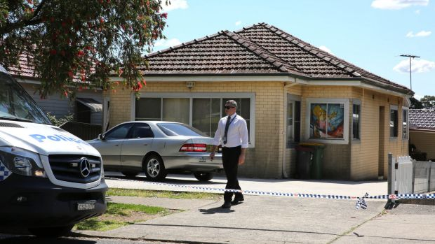 Police at the crime scene in Bass Hill after a man's body was found