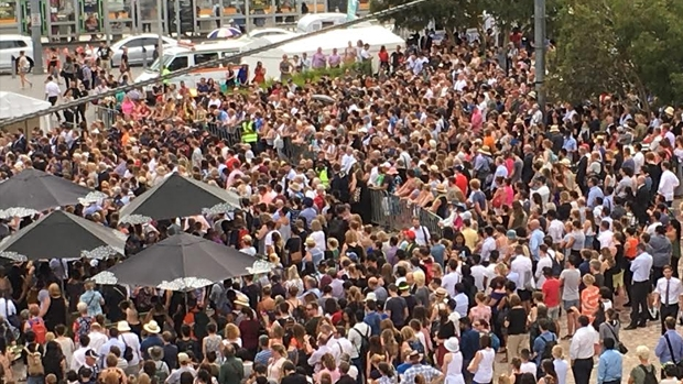 Thousands gather at Federation Square to pay their respects.