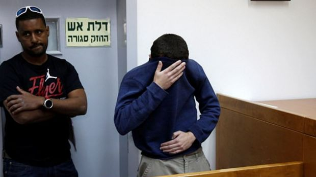 Michael Ron David Kadar, pictured in an Israeli court, was arrested after allegedly threatening schools, airlines, ...