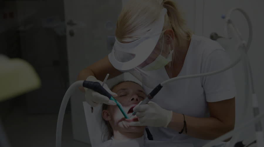 What is ultrasonic dental cleaning and when is it necessary?