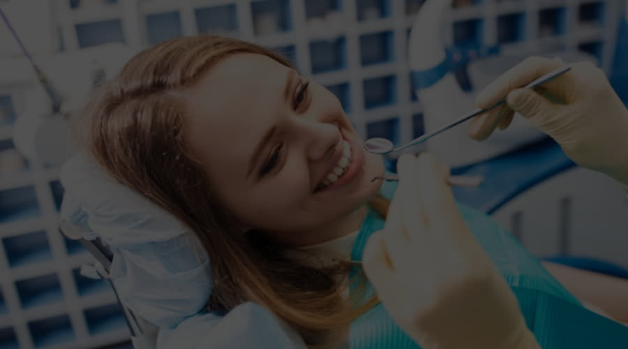 Why is it important to go to the dentist at least once a year?