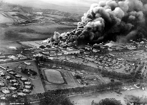 Burning planes and hangars at the Wheeler Field.