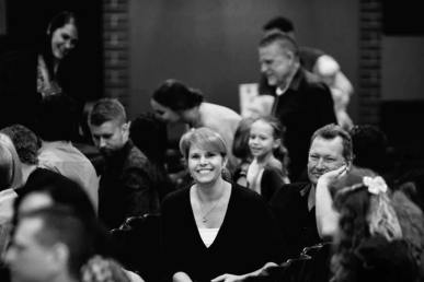 Black and white image of mum sitting in church