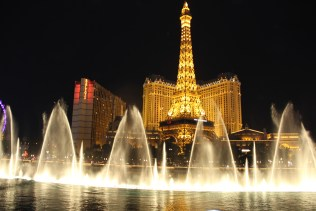 Fountain show with Eiffel Tower at the background
