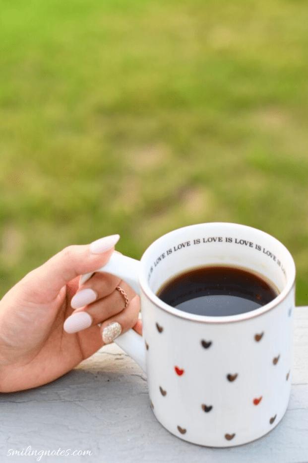 coffee mug in hand