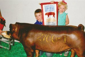 Two kids showing their pig at State Fair