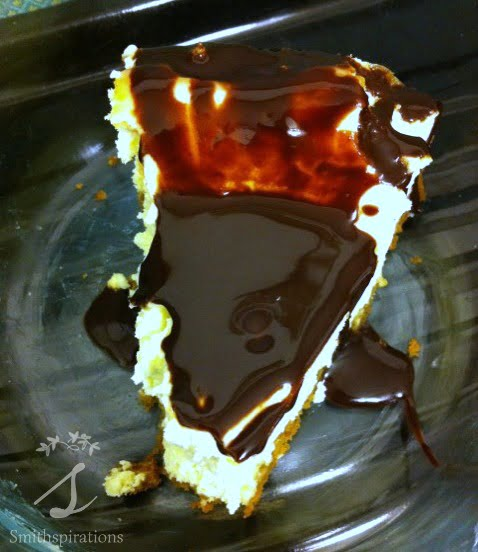 Dark chocolate sauce on cheesecake