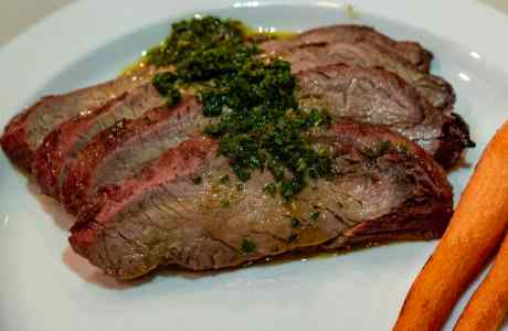 Smoked Flank Steak with carrot top chimichurri