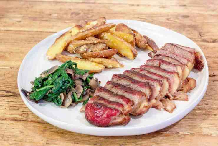 Sliced New York Strip from Crowd Cow with Spinach, and fingerling potatoes.#crowdcow #traeger #smokedmeat #steak