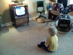 little josh looking at old TV