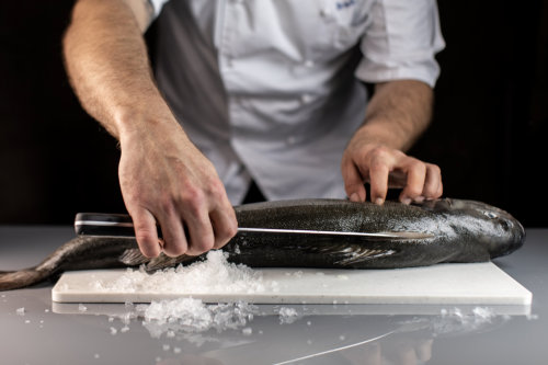 Chef Butchering Sablefish