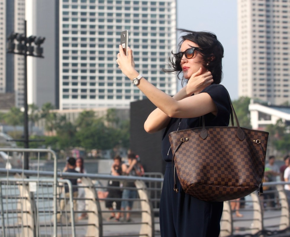a woman taking a selfie