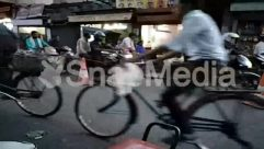 Advertisement, Alley, Alleyway, Apparel, Asphalt, Auto, Automobile, Banner, Bicycle, Bike, Buggy, Building, City, Coat, Cone, Crash Helmet, Cyclist, Gravel, Helmet, Human, Market, Motor Scooter, Motorcycle, Parking, Pedestrian, Person, Riding Bicycle, Road, Street, Tarmac, Traffic, Tricycle
