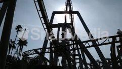 Amusement Park, Bridge, Building, Coaster, Construction Crane, Nature, Palm Tree, Roller Coaster, sky, Sunlight, Theme Park, Tree, Utility Pole