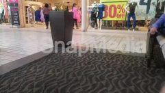 Apparel, Boutique, Clothing, Crowd, Floor, Flooring, Footwear, Furniture, Human, Indoors, Lobby, Person, Room, Rug, Shoe, Shop, Shopping Mall