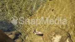 Adventure, Aerial View, Aircraft, Airplane, Algae, Amphibian, Animal, Apparel, Aquatic, Automobile, Bird, Boat, Buggy, Canoe, Car, Clothing, Field, Fish, Flight, Flying, Footwear, Grass, Ground, Land, Landscape, Leisure Activities, Mountain, Nature, Oars, Ocean, Outdoors, Path, Plant, Pollution, Reptile, River, Road, Rock, Rowboat, Sand, Scenery, Sea, Sea Life, Shoe, Shoreline, Slope