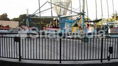 Adventure, Amusement Park, Barge, Boat, Carousel, Crowd, Dock, Fence, Ferris Wheel, Ferry, Gate, Human, Leisure Activities, Path, Person, Pier, Port, Railing, Theme Park, Transportation, Tugboat, Vehicle, Vessel, Water