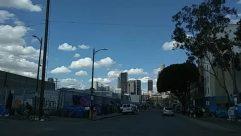 Alley, Alleyway, Apartment Building, Architecture, Asphalt, Automobile, Azure Sky, Building, Bus, Cable, Car, Car Dealership, Caravan, City, Cloud, Condo, Cumulus, Downtown, Factory, Freeway, High Rise, Highway, Housing, Human, Intersection, Lamp Post, Landscape, Metropolis