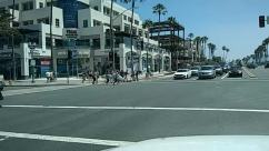 Person, Pedestrian, Human, Road, Street, Building, City, Town, Urban, Intersection, Asphalt, Tarmac, Downtown, Transportation, Car