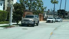 Urban, Person, Human, Building, Neighborhood, Transportation, Vehicle, Automobile, Car, Town, Road, City, Street, Sedan, Path
