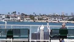Person, Human, Water, Waterfront, Pier, Port, Dock, Harbor, Railing, Vehicle, Transportation, Marina, Urban, Building, Path