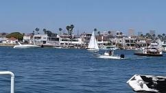 Vehicle, Vessel, Transportation, Watercraft, Person, Human, Boat, Water, Building, City, Town, Urban, Metropolis, Waterfront, Dock