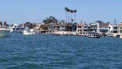 Water, Waterfront, Pier, Port, Dock, Harbor, Human, Person, Marina, Boat, Transportation, Vehicle, Building, Yacht, Housing