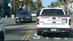 Human, Person, Automobile, Vehicle, Car, Transportation, Pickup Truck, Truck, Van, Ambulance, Road, Bumper, Word, Tarmac, Asphalt