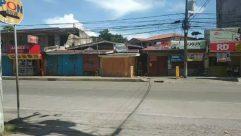 Urban, Building, Town, Street, Road, City, Wheel, Machine, Human, Person, Neighborhood, Vehicle, Transportation, Motorcycle, Slum