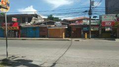 Urban, Building, Person, Human, Road, Town, City, Street, Neighborhood, Vehicle, Truck, Transportation, Slum, Machine, Wheel