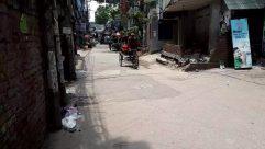 Street, Building, City, Urban, Road, Town, Person, Wheel, Machine, Path, Transportation, Bicycle, Bike, Vehicle, Flagstone
