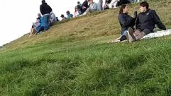 Plant, Grass, Person, Clothing, Apparel, Pants, Outdoors, Field, Lawn, Nature, Slope, Jeans, Denim, Photo, Photography