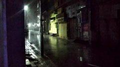 Person,Nature,Path,Pedestrian,Road,Building,City,Urban,Town,Street,Walkway,Lighting,Outdoors,Light,Metropolis,rain,rainfall,cyclone,storm,thunderstorm,ghost,scary,night,street light